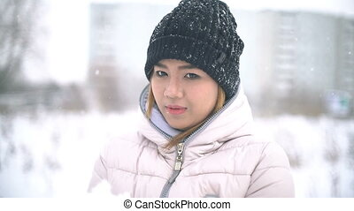 Thai Woman playing with snow slowmotion - Thai Woman playing...