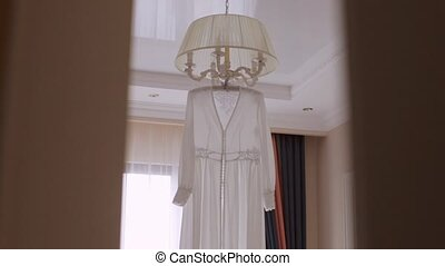 Chiffon wedding bridal dressing gown hanging on the hanger...