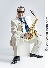 Music Concepts and Ideas Portrait of Male Stylish Saxophone...