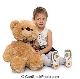 Girl with Teddy bear - Cute little girl hugging a big Teddy...