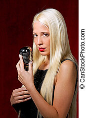 Young woman with a microphone as a singer