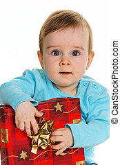 Small child with a birthday gift package - Small child with...
