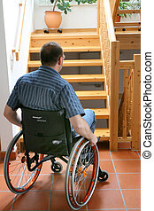 man with wheelchair - a man is sitting in a wheelchair