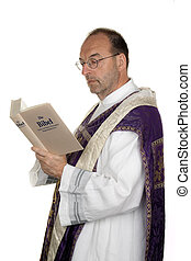Catholic Priest with Bible in church