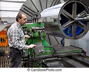 Older workers in the metal industry in CNC milling machine -...