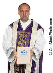 Catholic Priest with Bible in church - a Catholic priest...