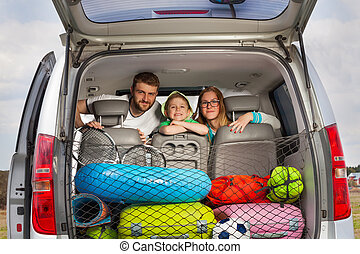 Happy young family ready for a car trip