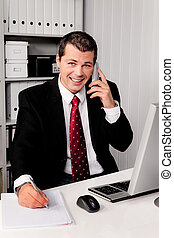 Businessman in office with telephone