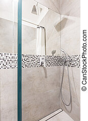 Glass walled shower - Modern glass walled shower with a...