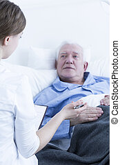 High standard of care - Young nurse talking to the senior...