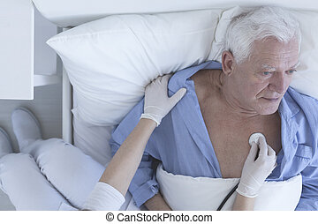 Waiting for quick recovery - Shot of a nurse doing a medical...