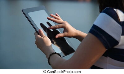 Girl Touching Tablet Computer