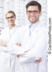 Young opticians specialists - Portrait of opticians...