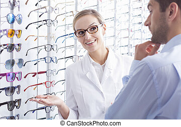 Difficult glasses choice - Male optician patient and...