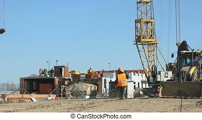 Builder goes to the background construction site - Builder...