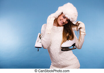 Happy young lady with skates. - Winter, sport concept. Happy...