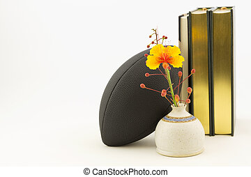 Football and books - Scholar athlete symbols of success in...