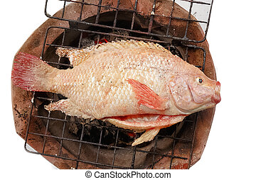 Grilled red nile tilapia fish on charcoal stove