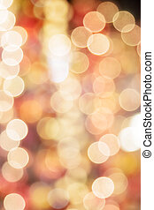 Abstract blurred bokeh light in warm tone background