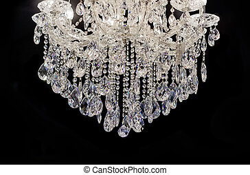 Chrystal chandelier close-up. black background with copy...