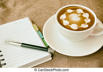 blank paper note with pen and cup of coffee on desk