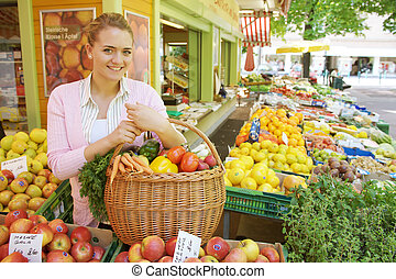 Woman at the vegetable and fruit market