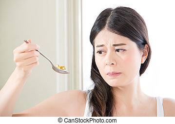 beautiful asian woman scared to eat too much nutritional...