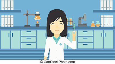 Laboratory assistant with syringe in lab. - An asian female...