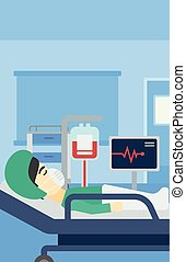 Patient lying in hospital bed with heart monitor - An asian...