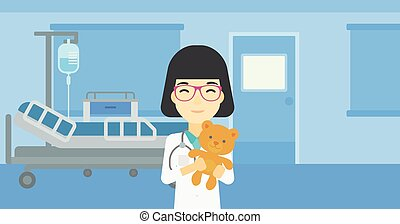 Pediatrician doctor holding teddy bear - Young asian female...