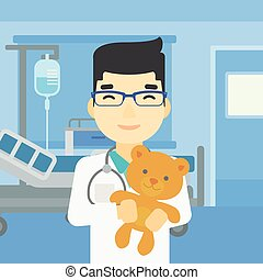 Pediatrician doctor holding teddy bear - Young asian male...