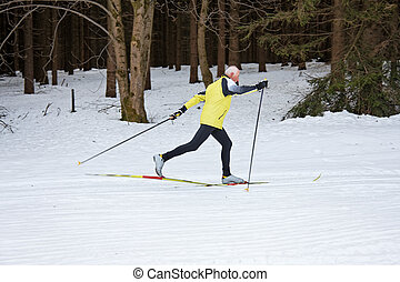 Senior cross country skiing during the winter