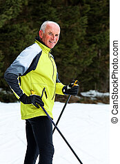 Senior cross country skiing during the winter - Senior at...