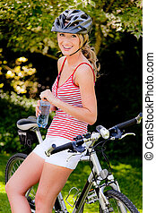Woman with mountain bike