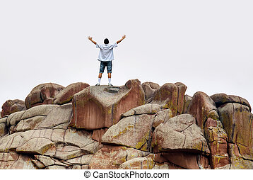 Man standing on the mountain above bright sky - Man on top...