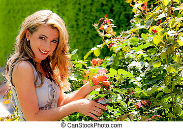 Woman with garden shears and Rose