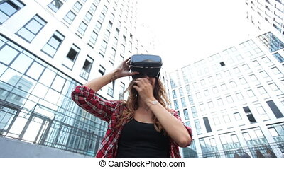 Woman using a virtual reality device against low angle view...