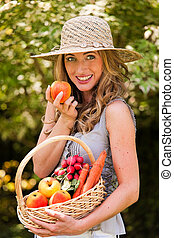 Woman with fruits and vegetables from the garden - Woman...