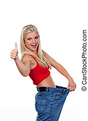 Woman after a successful diet with large pants - Young woman...