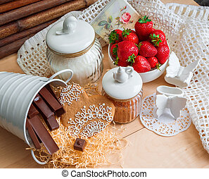 strawberries, cookies, chocolates candies on the table,...