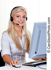 Woman with a headset and computer Hotline at - Young Woman...