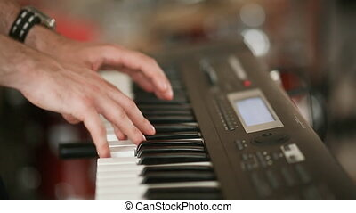 The hands of the musician played on a synthesiser,