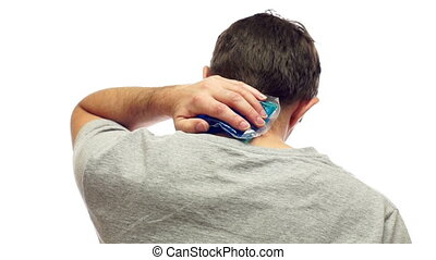 Man With Cold Pack For Neck Pain - Middle aged man isolated...