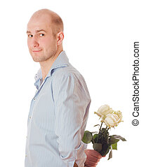 Man with roses - Picture of a young male hiding a flower...
