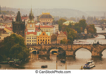 Center of Prague city at autumn with red roofs and Charles...