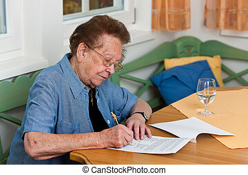 Senior citizen signs a contract