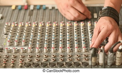 The hands of the men work with mixer,