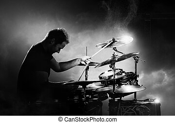 Drummer playing drums - Drummer playing the drums with smoke...