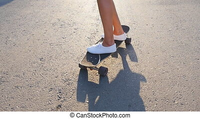 Girl riding on a skateboard - Girl with skateboard at the...