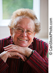Friendly smiling positive senior citizen - Portrait of a...